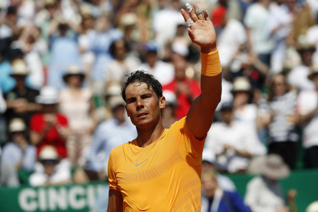 Spain's Rafael Nadal waves to the crowd after winning the semifinal match against Bulgaria's Gregor Dimitrov af the Monte Carlo Tennis Masters tournament in Monaco, Saturday April 21, 2018. (AP Photo/Christophe Ena)