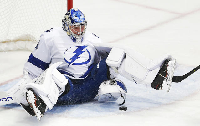 Tampa Bay Lightning goaltender Andrei Vasilevskiy (88) stops a shot during the first period of an NHL hockey game against the Dallas Stars, Tuesday, Jan. 15, 2019, in Dallas. (AP Photo/Brandon Wade)