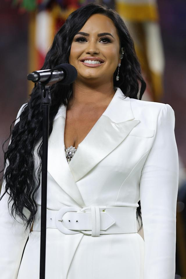 MIAMI, FLORIDA - FEBRUARY 02: Singer Demi Lovato performs the national anthem prior to Super Bowl LIV between the San Francisco 49ers and the Kansas City Chiefs at Hard Rock Stadium on February 02, 2020 in Miami, Florida. (Photo by Tom Pennington/Getty Images)