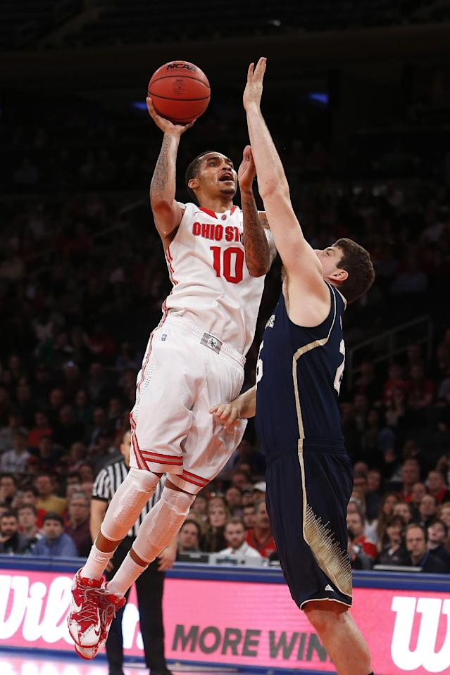 Ohio State's LaQuinton Ross (10) shoots against Notre Dame's Tom Knight during the first half of an NCAA college basketball game Saturday, Dec. 21, 2013, in New York. (AP Photo/Jason DeCrow)