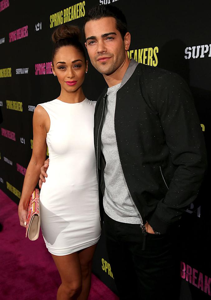 """Jesse Metcalfe (R) and Cara Santana attend the """"Spring Breakers"""" premiere at ArcLight Cinemas on March 14, 2013 in Hollywood, California."""