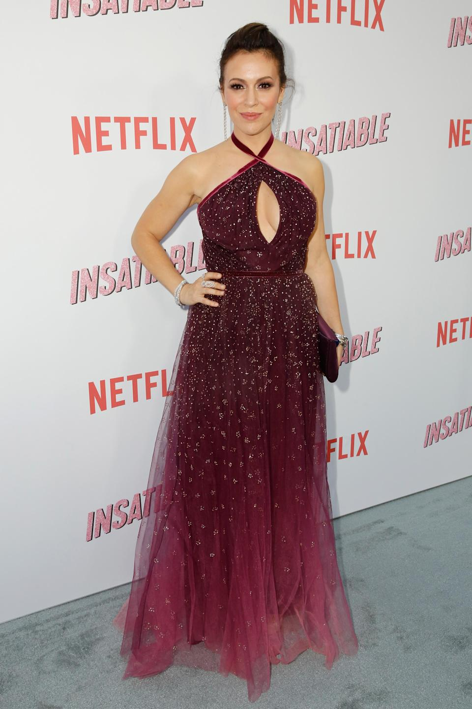 <p>The former 'Charmed' actress had a fairytale moment on the red carpet in this purple number. <em>[Photo: Getty]</em> </p>