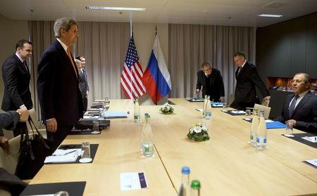 U.S. Secretary of State John Kerry takes his seat across the table from Russian Foreign Minister Sergey Lavrov, for their meeting about Syria, in Zurich, Switzerland, January 20, 2016.   REUTERS/Jacquelyn Martin/Pool