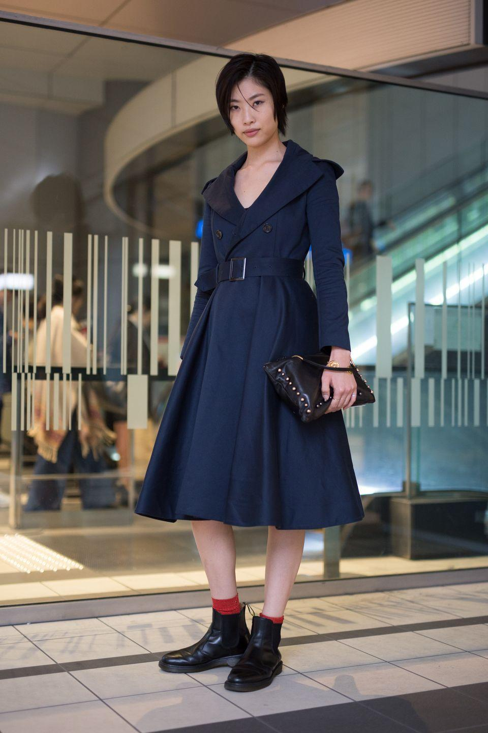 """<p>Fans of the traditional trench silhouette will love the dress, shirt, and jumpsuit iterations just as much. Splurging on a deconstructed style will ensure you're polished at all times. </p><p><strong>Get the look: Staud </strong>Jacklyn topstitched cotton-blend twill wrap dress, $315, <a href=""""https://www.neimanmarcus.com/p/staud-jacklyn-midi-wrap-dress-prod236820277?utm_source=google_shopping&adpos=&scid=scplpsku198510939&sc_intid=sku198510939&ecid=NMCS__GooglePLA&gclid=CjwKCAjw0On8BRAgEiwAincsHEnXXryfYsN_CC_bc7ltGOs3lmKxFARbRHUj5-fSPg9BjGMrcUfDJRoCJ5EQAvD_BwE&gclsrc=aw.ds"""" rel=""""nofollow noopener"""" target=""""_blank"""" data-ylk=""""slk:neimanmarcus.com"""" class=""""link rapid-noclick-resp"""">neimanmarcus.com</a>.</p>"""