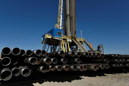 Drill pipe is seen below a drilling rig on a lease owned by Oasis Petroleum in the Permian Basin near Wink
