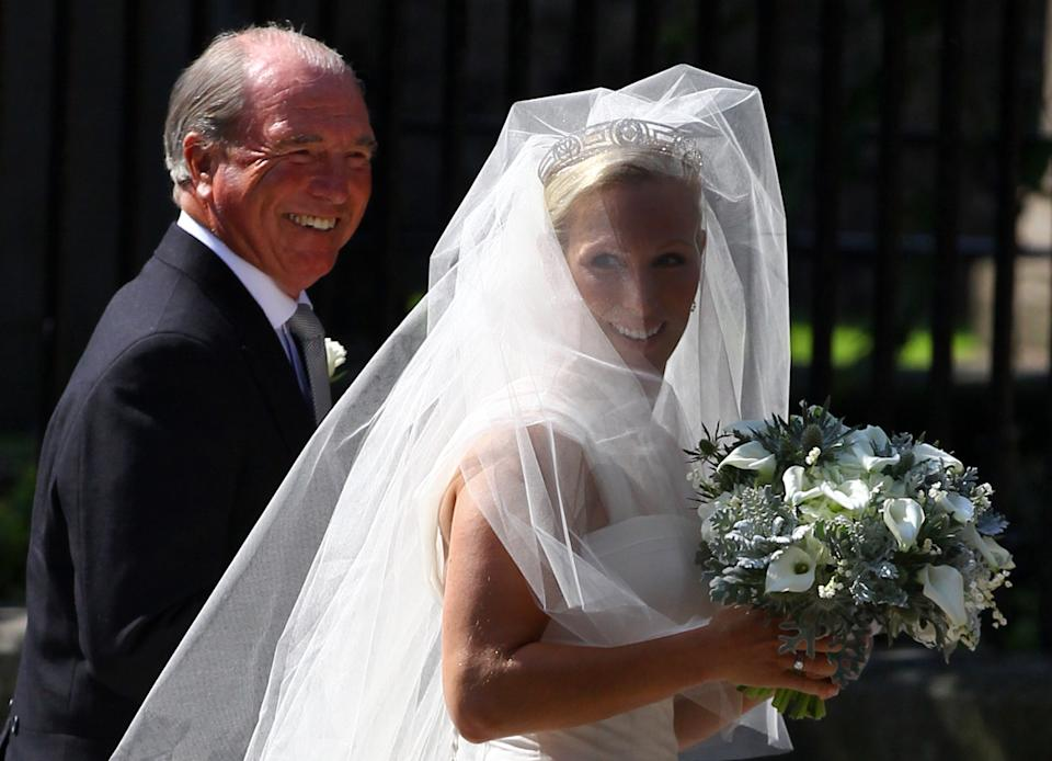 <p>Captain Mark Phillips and Zara Phillips before the wedding. He walked her down the aisle. (Jeff J Mitchell/Getty Images)</p>
