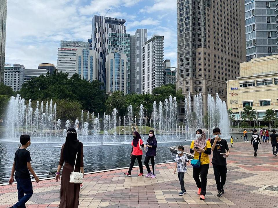 People spend the afternoon at KLCC Park in Kuala Lumpur October 10, 2021. — Picture by Yusof Mat Isa