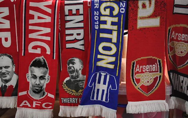 Scarves at a fan stall outside the Emirates Stadium ahead of the English Premier League soccer match Arsenal v Brighton in London, Britain, 05 December 2019. Arsenal vs Brighton, - ANDY RAIN/EPA-EFE/REX