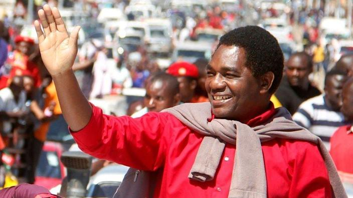 Zambian opposition leader Hakainde Hichilema waves at his supporters after being released from prison after treason charge against him were dropped on August 16, 2017 in Lusaka