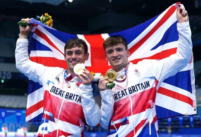 Tom Daley and Matty Lee show off their gold medals