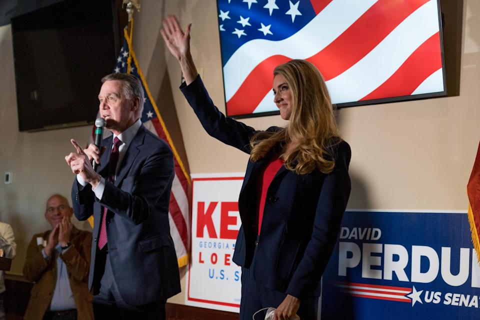 David Perdue and Kelly Loeffler speak at a campaign event