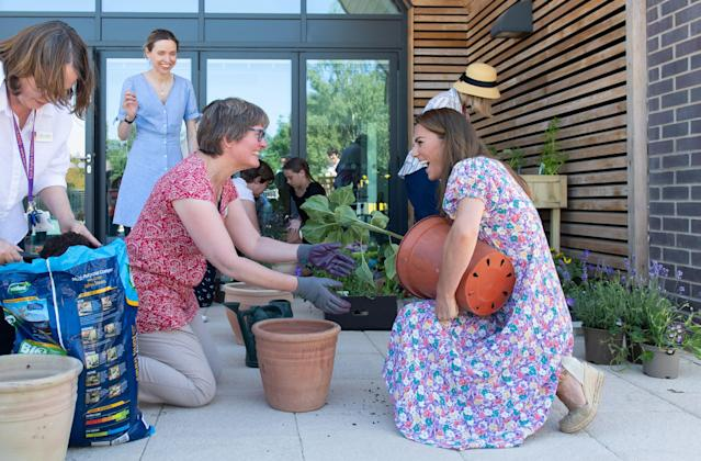 The Duchess of Cambridge helps to pot plants and herbs in the sensory garden. (PA Images)