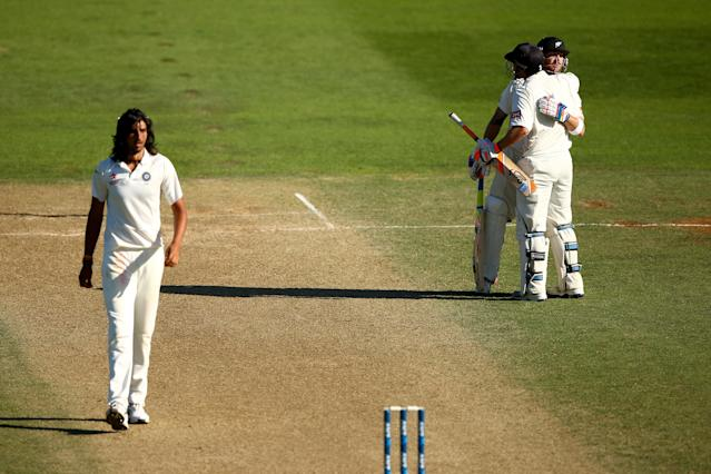 WELLINGTON, NEW ZEALAND - FEBRUARY 16: Brendon McCullum of New Zealand celebrates his century with BJ Watling as Ishant Sharma of India walks back during day three of the 2nd Test match between New Zealand and India at the Basin Reserve on February 16, 2014 in Wellington, New Zealand. (Photo by Phil Walter/Getty Images)
