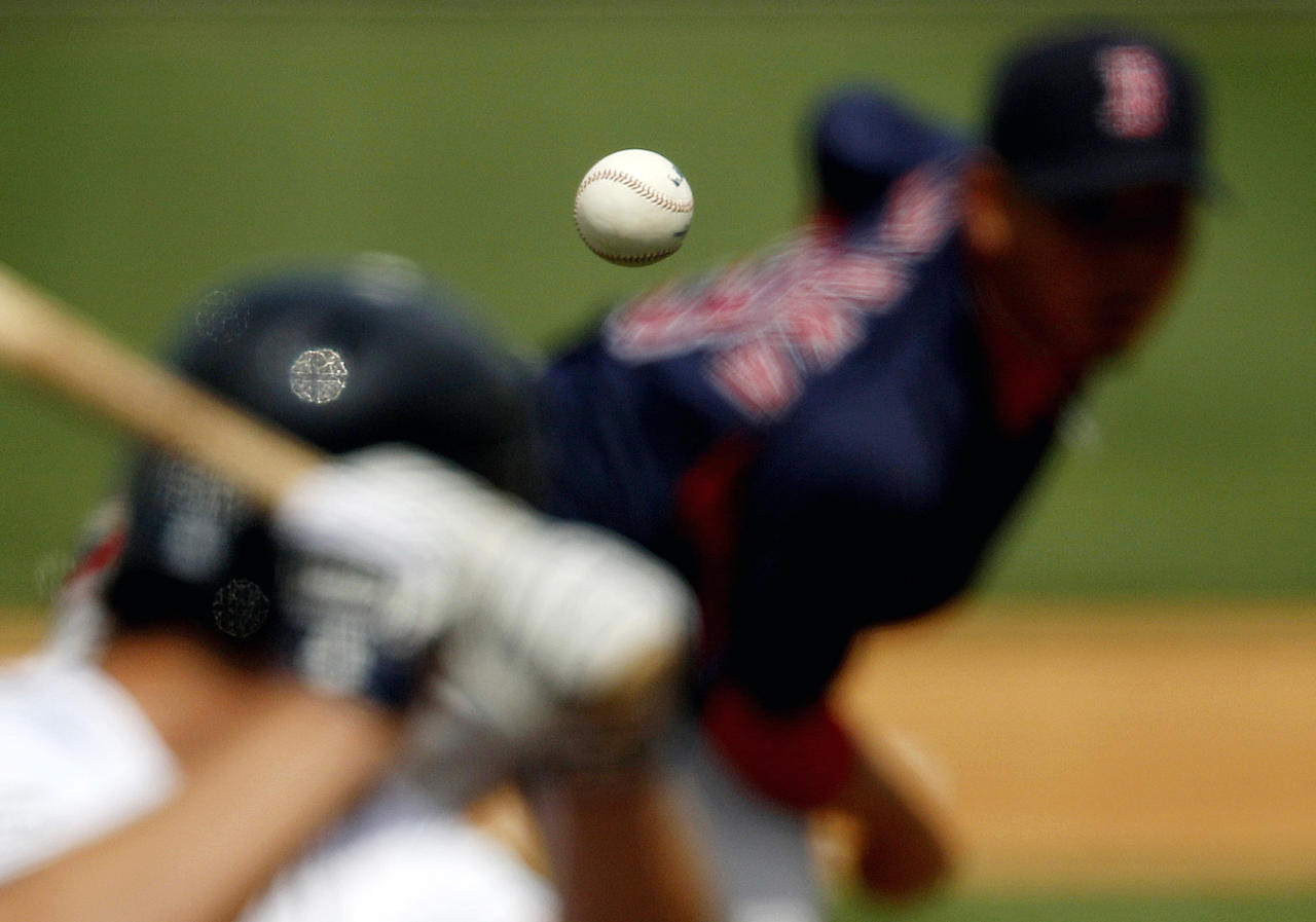<p>Boston Red Sox starting pitcher Daisuke Matsuzaka, right, of Japan, pitches to Detroit Tigers' Scott Sizemore during the fifth inning of a spring training baseball game, March 15, 2011 in Lakeland, Fla. (AP Photo/David Goldman) </p>