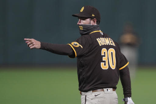 San Diego Padres first baseman Eric Hosmer (30) gestures during the eighth inning of a baseball game against the San Francisco Giants in San Francisco, Tuesday, July 28, 2020. (AP Photo/Jeff Chiu)