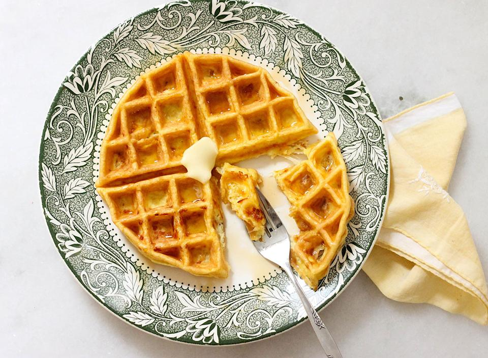 Biting into a keto waffle - 63+ Best Healthy Keto Recipes To Keep You In Ketosis