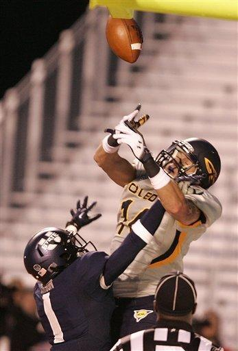 Toledo's Justin Olack, top, tries to pull down a reception against Utah State's Nevin Lawson (1) during the second half of an NCAA college football game on Saturday, Dec. 15, 2012, in Boise, Idaho. Utah State went on to win the Famous Idaho Potato Bowl game 41-15. (AP Photo/Matt Cilley)