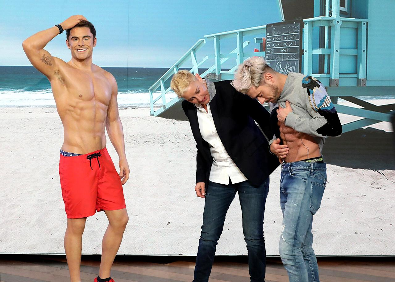 "It's been a couple of years since <a href=""https://people.com/bodies/baywatch-female-empowerment-men-more-objectified/""><em>Baywatch</em></a> hit theaters, but Zac Efron has still kept his abs as a souvenir.  The 31-year-old actor dropped by <em>The Ellen DeGeneres Show </em>to talk about his Neflix film <a href=""https://people.com/movies/zac-efron-ted-bundy-movie-trailer/""><em>Extremely Wicked, Shockingly Evil and Vile</em></a>, where he indulged the host in a bit of lighthearted conversation about their respective Madame Tussauds wax figures.  DeGeneres brought out Efron's to show how striking the resemblance was, capturing the actor in <a href=""https://people.com/movies/alexandra-daddario-zac-efron-abs-baywatch/"">all his shirtless <em>Baywatch </em>glory</a>, complete with bicep tattoo and armpit hair."
