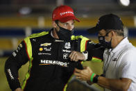Simon Pagenaud, left, of France, celebrates in Victory Lane after winning an IndyCar Series auto race Friday, July 17, 2020, at Iowa Speedway in Newton, Iowa. (AP Photo/Charlie Neibergall)