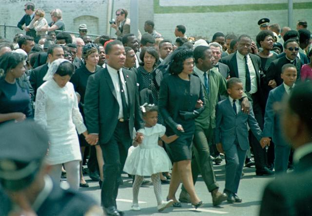 <p>Coretta Scott King walks in the funeral procession with her children and family. From left are daughter Yolanda, 12; King's brother A.D. King; Bernice, 5; King; Rev. Ralph Abernathy; Dexter, 7; and Martin Luther King III, 10. (Photo: AP) </p>