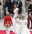 <p>The four bridesmaids wore head wreaths made of lily of the valley flowers and ivy, which the bridge chose as a tribute to her parents - as her mother Carole wore one just like it on her own wedding day in 1981.</p>