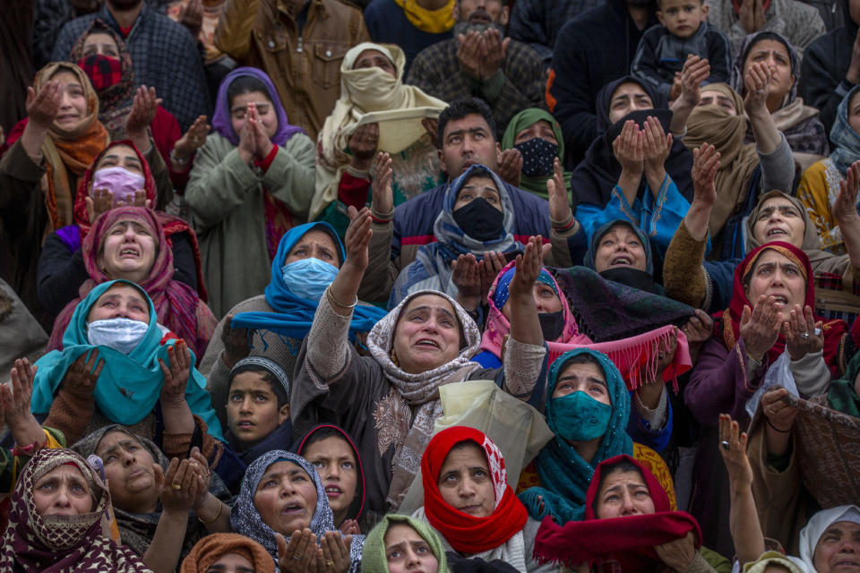 Kashmiri Muslim women pray as the head priest displays a relic at the Hazratbal shrine on the occasion of Mehraj-u-Alam, believed to mark the ascension of Prophet Muhammad to heaven, in Srinagar, Indian controlled Kashmir, Friday, March 12, 2021. (AP Photo/Dar Yasin)