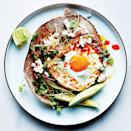"""Creamy avocado and crunchy sprouts cool off this spicy breakfast taco filled with crisp-edged eggs and feta. It's a great breakfast taco, but we'd eat it any time. <a href=""""https://www.epicurious.com/recipes/food/views/chile-and-olive-oil-fried-egg-with-avocado-and-sprouts-51260270?mbid=synd_yahoo_rss"""" rel=""""nofollow noopener"""" target=""""_blank"""" data-ylk=""""slk:See recipe."""" class=""""link rapid-noclick-resp"""">See recipe.</a>"""