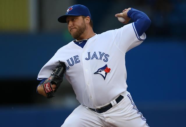 TORONTO, CANADA - JUNE 19: Mark Buehrle #56 of the Toronto Blue Jays delivers a pitch during MLB game action against the Colorado Rockies on June 19, 2013 at Rogers Centre in Toronto, Ontario, Canada. (Photo by Tom Szczerbowski/Getty Images)