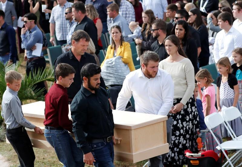 Men carry the remains of Dawna Ray Langford, 43, and her sons Trevor, Rogan, who were killed by gunmen, before they are buried at the cemetery in La Morita, Sonora