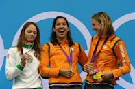 Silver medallist Aliaksandra Herasimenia of Belarus, gold medallist Ranomi Kromowidjojo of Netherlands, and bronze medallist Marleen Veldhuis of Netherlands pose on the podium during the medal ceremony Women's 50m Freestyle Final on Day 8 of the London 2012 Olympic Games at the Aquatics Centre on August 4, 2012 in London, England. (Photo by Clive Rose/Getty Images)