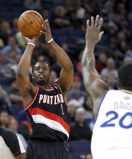 Portland Trail Blazers Wesley Matthews (2) takes a 3-point shot over Golden State Warriors' Ekpe Udoh (20) during the first half of an NBA basketball game in Oakland, Calif., Wednesday, Feb. 15, 2012. (AP Photo/Tony Avelar)
