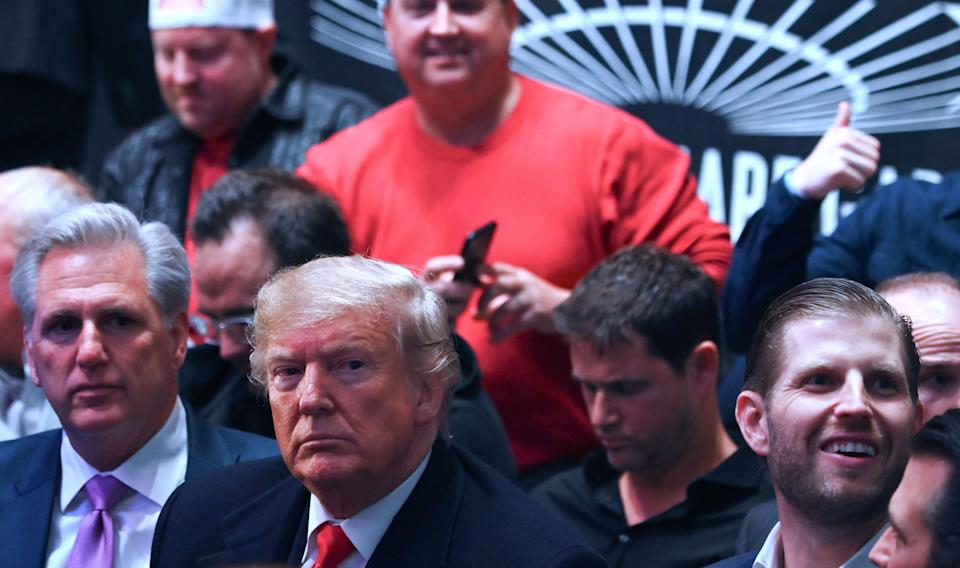 US President Donald Trump (C), his son Eric Trump (R) and House Minority Leader Kevin McCarthy (L) watch the Ultimate Fighting Championship at Madison Square Garden in New York City, New York on November 2, 2019. (Photo by Andrew Caballero-reynolds / AFP) / The erroneous mention[s] appearing in the metadata of this photo by Andrew Caballero-reynolds has been modified in AFP systems in the following manner: [House Minority Leader Kevin McCarthy] instead of [Republican US representative for North Carolina Mark Meadows]. Please immediately remove the erroneous mention[s] from all your online services and delete it (them) from your servers. If you have been authorized by AFP to distribute it (them) to third parties, please ensure that the same actions are carried out by them. Failure to promptly comply with these instructions will entail liability on your part for any continued or post notification usage. Therefore we thank you very much for all your attention and prompt action. We are sorry for the inconvenience this notification may cause and remain at your disposal for any further information you may require. (Photo by ANDREW CABALLERO-REYNOLDS/AFP via Getty Images)