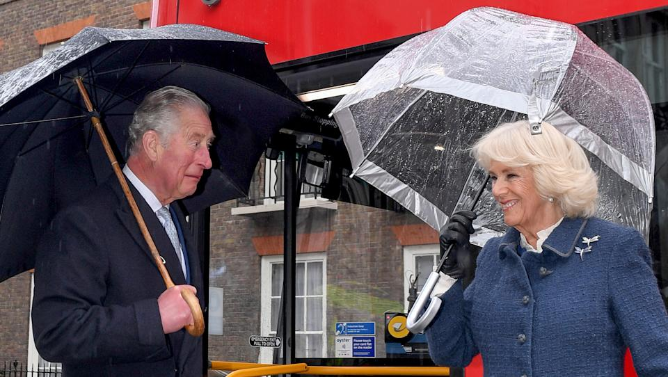 Britain's Prince Charles, Prince of Wales (L) and Britain's Camilla, Duchess of Cornwall prepare to board a new electric double decker bus at Clarence House, before travelling towards the London Transport Museum to take part in celebrations to mark 20 years of Transport for London (TfL) on March 4, 2020, in London. - TfL was set-up in 2000 to bring Londons transport network together under one integrated body. (Photo by Stuart C. Wilson / POOL / AFP) (Photo by STUART C. WILSON/POOL/AFP via Getty Images)