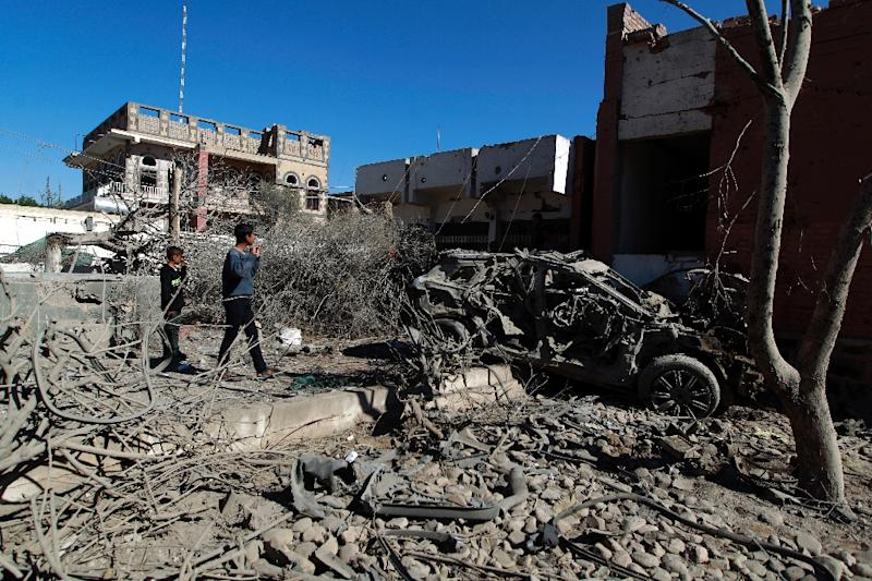 Yemenis inspect the damage following an air-strike by the Saudi-led coalition in the capital Sanaa, on February 27, 2016