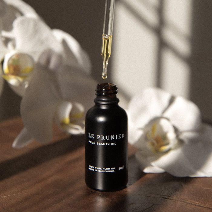 "Le Prunier's plum beauty oil is <a href=""https://www.huffingtonpost.com/entry/best-face-oils-serums_us_5a71d532e4b0a6aa48753cbb"" rel=""nofollow noopener"" target=""_blank"" data-ylk=""slk:one of our favorite&nbsp;facial&nbsp;oils"" class=""link rapid-noclick-resp"">one of our favorite&nbsp;facial&nbsp;oils</a>, but it can also be used as a hair oil, to protect your locks from heat damage and keep your ends feeling soft and smooth.&nbsp;<strong><a href=""https://www.leprunier.com/product/plum-beauty-oil"" rel=""nofollow noopener"" target=""_blank"" data-ylk=""slk:Le Prunier plum beauty oil"" class=""link rapid-noclick-resp""><br><br>Le Prunier plum beauty oil</a>, $72</strong>"