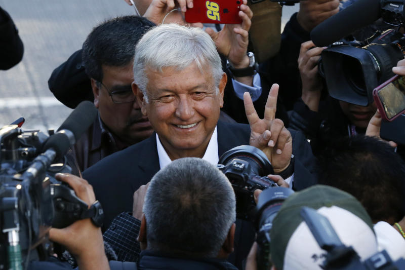 Presidential candidate Andres Manuel Lopez Obrador, of the MORENA party, arrives to a polling station to vote during general elections in Mexico City, Sunday, July 1, 2018. Sunday's elections for posts at every level of government are Mexico's largest ever and have become a referendum on corruption, graft and other tricks used to divert taxpayer money to officials' pockets and empty those of the country's poor. (AP Photo/Marco Ugarte)
