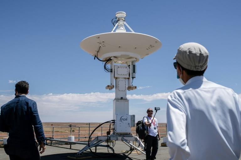 Japan Aerospace Exploration Agency (JAXA) officials and reporters tour the roof of the Royal Australian Air Force's (RAAF) Woomera Range Complex in South Australia ahead of the capsule's arrival