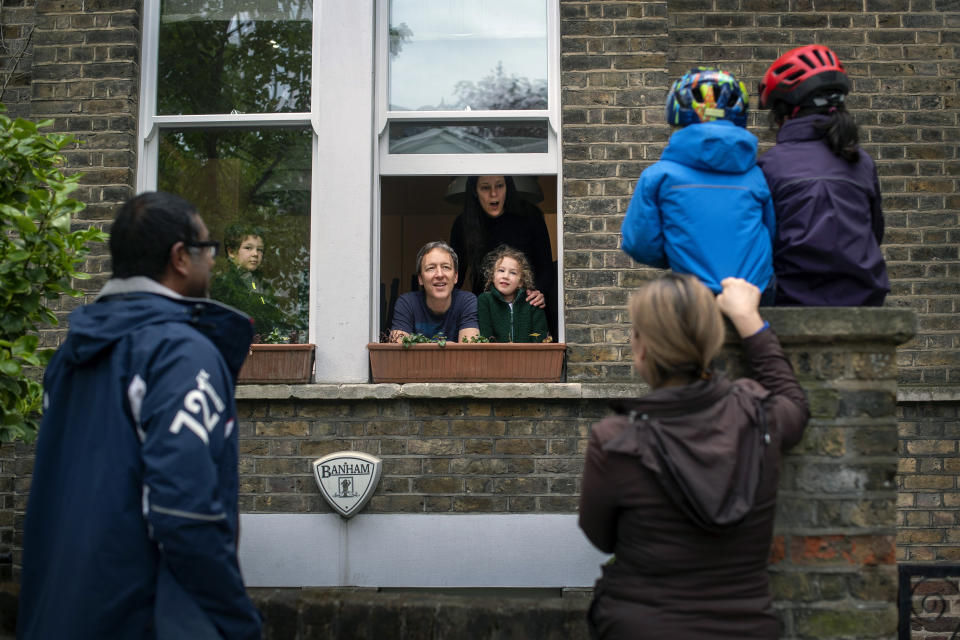**Parental permission granted** Two families maintain social distancing while talking to each other outside a home in Hampstead, north London, as the UK continues in lockdown to help curb the spread of the coronavirus. (Photo by Victoria Jones/PA Images via Getty Images)