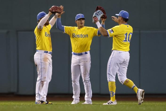 Boston Red Sox outfielders, from left, Alex Verdugo, Enrique Hernandez and Hunter Renfroe celebrate after the Red Sox defeated the Baltimore Orioles in a baseball game Friday, Sept. 17, 2021, in Boston. (AP Photo/Michael Dwyer)