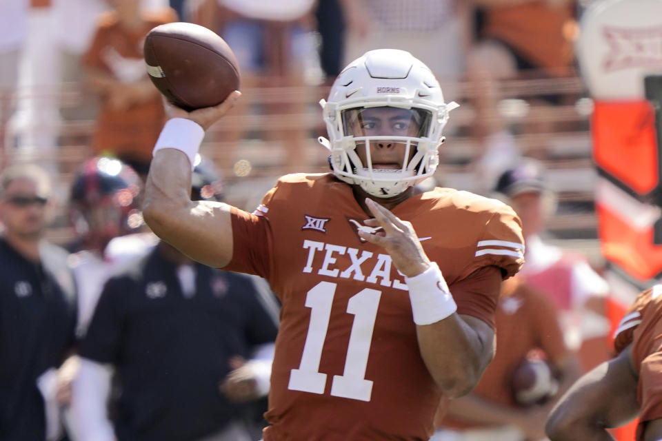Texas quarterback Casey Thompson (11) looks to pass against Texas Tech during the first half of an NCAA college football game on Saturday, Sept. 25, 2021, in Austin, Texas. (AP Photo/Chuck Burton)