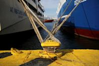 Passenger ships are moored during a 24-hour strike, at the port of Piraeus