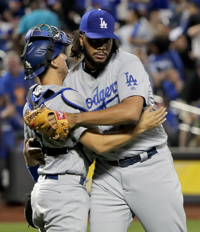 Los Angeles Dodgers pitcher Kenley Jansen, right, celebrates with catcher Austin Barnes after they defeated the New York Mets in a baseball game, Friday, June 22, 2018, in New York. (AP Photo/Julie Jacobson)