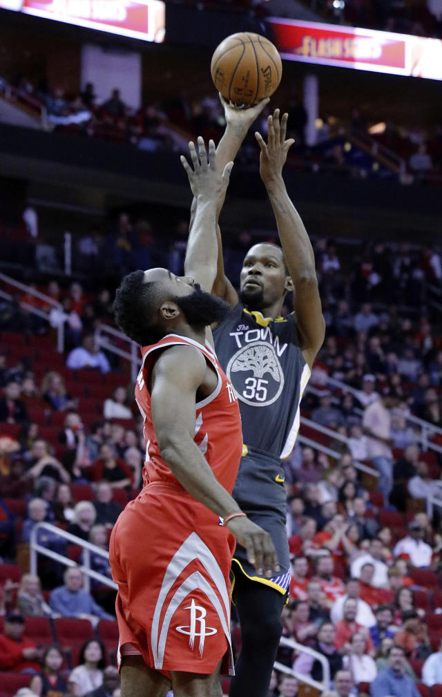 Golden State Warriors forward Kevin Durant (35) puts up a shot over Houston Rockets guard James Harden (13) during the first half of an NBA basketball game Saturday, Jan. 20, 2018, in Houston. (AP Photo/Michael Wyke)