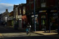 Man cycles past a branch of Subway in the centre of Sheerness, on the Isle of Sheppey