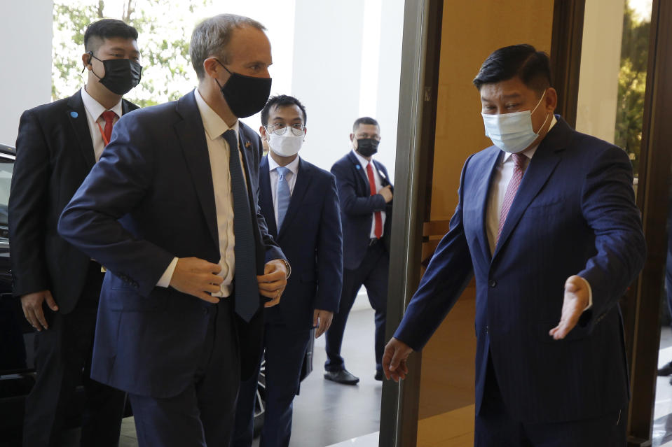 Britain's Foreign Secretary Dominic Raab, front left, meets Cambodian's Environment Minister Say Sam Al , right, on his arrival at Environment Ministry in Phnom Penh, Cambodia Wednesday, June 23, 2021. Raab is on his two-day official visit to Cambodia. (AP Photo/Heng Sinith)