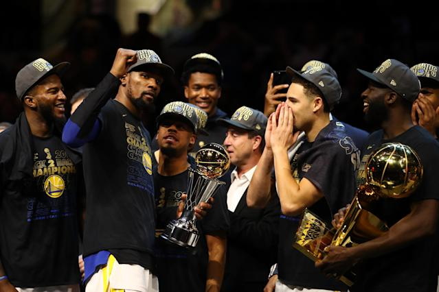 CLEVELAND, OH - JUNE 08: Kevin Durant #35 of the Golden State Warriors celebrates with the NBA Finals MVP trophy after defeating the Cleveland Cavaliers during Game Four of the 2018 NBA Finals at Quicken Loans Arena on June 8, 2018 in Cleveland, Ohio. The Warriors defeated the Cavaliers 108-85 to win the 2018 NBA Finals. (Photo by Gregory Shamus/Getty Images)