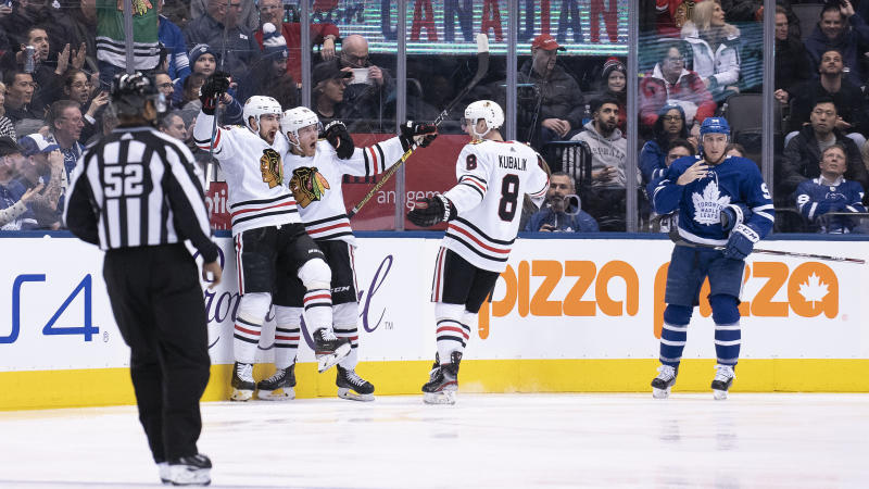 Chicago Blackhawks forward Dominik Kubalik celebrates with teammates after putting on a masterful performance against the Toronto Maple Leafs. (Nick Turchiaro-USA TODAY Sports)