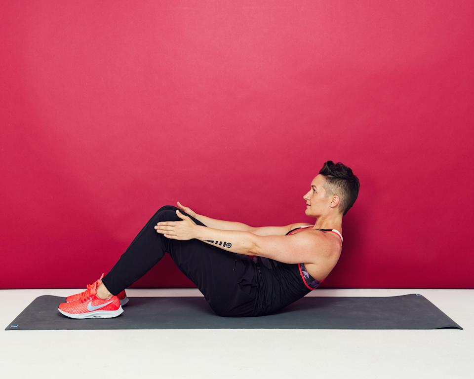 """<p>""""This is an isometric hold in the most intense part of a sit-up. What you're doing is working your abs by keeping them under constant tension. It's also a safe position [for your back to stay in] because your tailbone is tucked and your spine is lengthened instead of compressed.""""<br> —Stokes</p> <p><strong>How to do it:</strong></p> <ul> <li>Sit on your tailbone with your knees bent and feet flat on the floor. Hold onto each leg just above the knee.</li> <li>Round your spine, tuck your tailbone, and begin to lower your torso back, as if you were lowering back after a sit-up.</li> <li>About halfway (like in the photo above), stop and hold. Keep your entire core and your quads engaged.</li> <li>For an extra challenge, let go of your legs and just hold your arms out in front of you.</li> </ul>"""