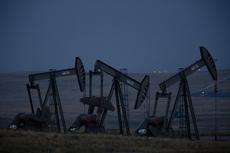 Pumpjacks operate at an oil well site near Gillette, Wyoming. Natural resources are the lifeblood of the state's economy.