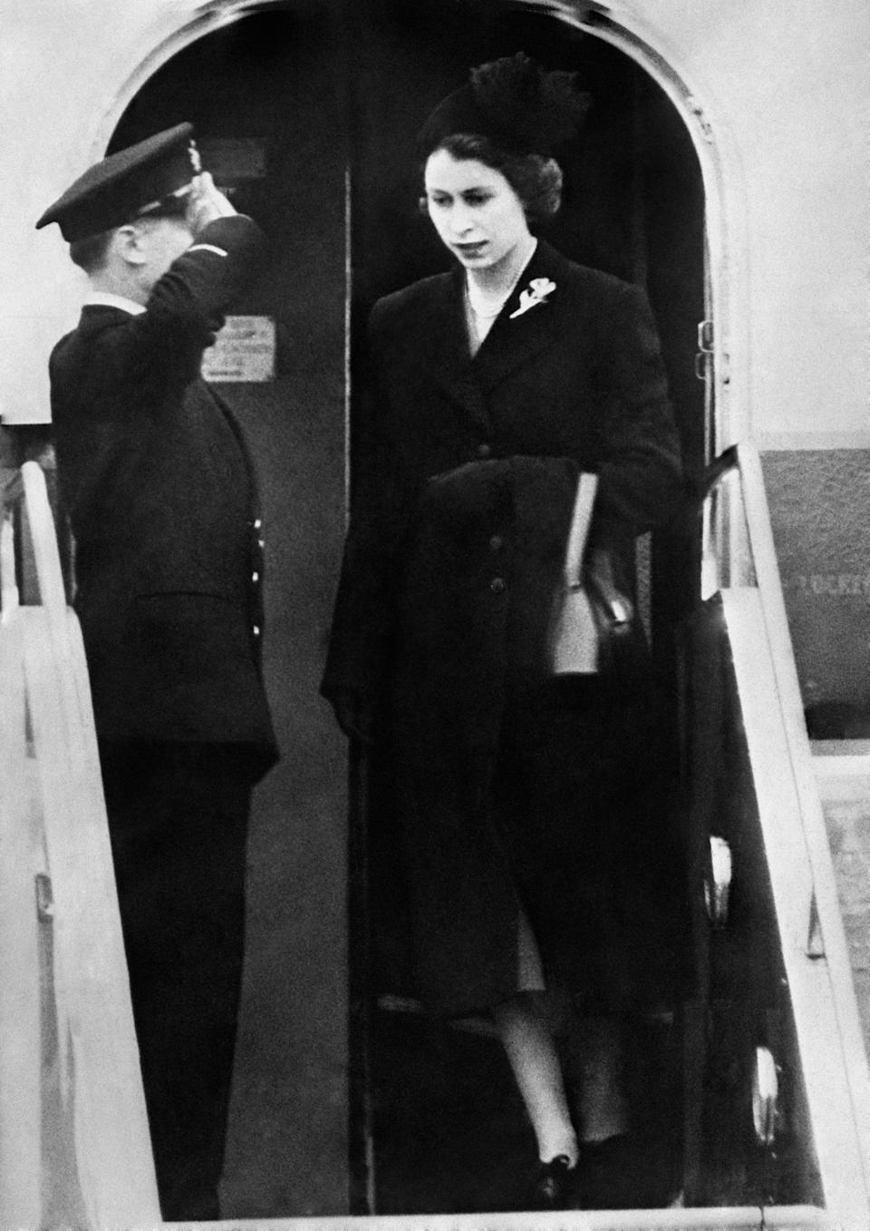 Dressed in black Queen Elizabeth II sets foot on British soil for the first time since her accession as she lands at London Airport after her day and night flight from Kenya following the death of her father, King George VI.   (Photo by PA Images via Getty Images)
